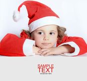 Little girl in Santa's hat Royalty Free Stock Photos