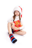Little girl with santa's hat Stock Photo