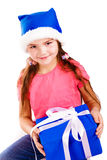 Little girl in Santa's hat with blue gift box Royalty Free Stock Photography