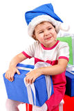 Little girl in Santa's hat with blue gift box Stock Image