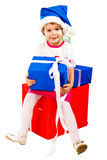 Little girl in Santa's hat with blue gift box Stock Images