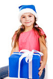 Little girl in Santa's hat with blue gift box Royalty Free Stock Image