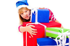 Little girl in Santa's hat with blue gift box Stock Photos