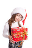 Little girl with santa's hat and gift holding Stock Photo