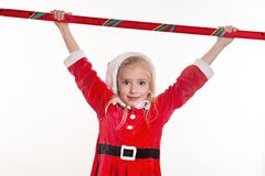 Little girl in a Santa suit Stock Image