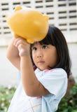 Little girl saving money in a piggybank Stock Photography