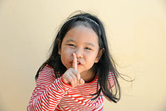 Little girl say silence is a secret Royalty Free Stock Photography