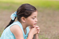 Little girl saying his prayers Royalty Free Stock Image