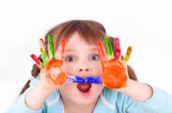 Little girl scares her colored hands Stock Images