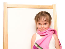 Little girl in scarf at whiteboard Stock Photo