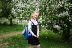 Little girl with a school backpack. The concept of school, study, education, friendship, childhood stock photo