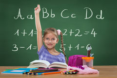 Little girl in the school, and behind the plate letters Stock Images