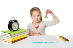The little girl at school desk. Rings by bell Stock Photos