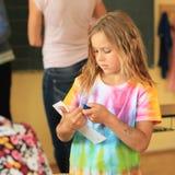 Little girl in school Stock Images