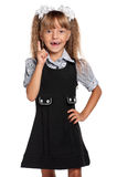 Little girl in school uniform Stock Images