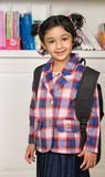 Little Girl in a School Uniform. With a Backpack Royalty Free Stock Images