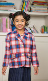 Little Girl in School Uniform. In a Classroom Royalty Free Stock Image
