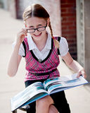 Little Girl in School Uniform and Glasses Stock Photography