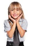 Little girl in school uniform Stock Images