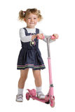 Little girl on scooter Stock Images