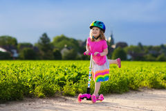 Little girl on a scooter Royalty Free Stock Image