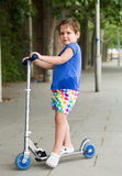 Little girl with scooter Royalty Free Stock Image