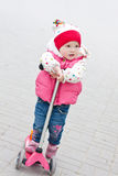 Little girl on scooter Stock Photo