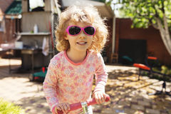 Little girl with scooter Stock Image
