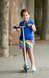 Little girl with scooter Royalty Free Stock Images