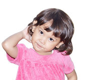 Little girl scratching Stock Image