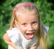 Little girl screaming Stock Image