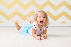 Little girl screaming with happiness. Little girl screaming with joy in the studio stock photos