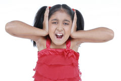 Little girl screaming in red dress Royalty Free Stock Photography