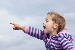 Little girl screaming and showing something Royalty Free Stock Images