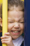 Little girl with a scrunched face royalty free stock photo