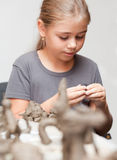 Little girl sculpts Stock Photos