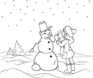 Little girl sculpts snowman. Winter Holdays Royalty Free Stock Photo