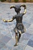 Little girl. Sculpture little girl in the park Stock Photo