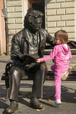Little girl and sculpture of poet Laza Kostic Stock Image