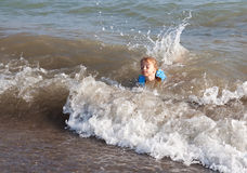 Little girl in the Sea. Stock Photography