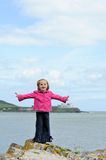 Little Girl by the Sea Stock Photo