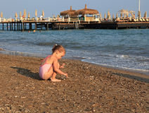 Little girl on sea beach. Stock Photo
