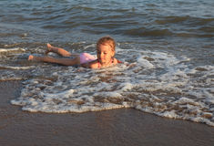 Little girl on sea beach. Royalty Free Stock Image