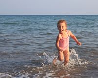 Little girl on sea beach. Royalty Free Stock Photo