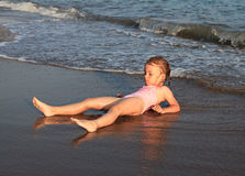 Little girl on sea beach. Royalty Free Stock Images