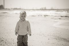 Little girl on sea, black and white photo Stock Photography