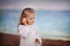 Little girl on sea Stock Photo