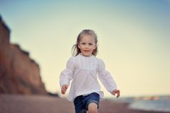 Little girl on sea Royalty Free Stock Images