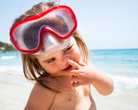 Little girl at sea with mask Stock Image