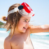 Little girl at sea with mask Stock Photo